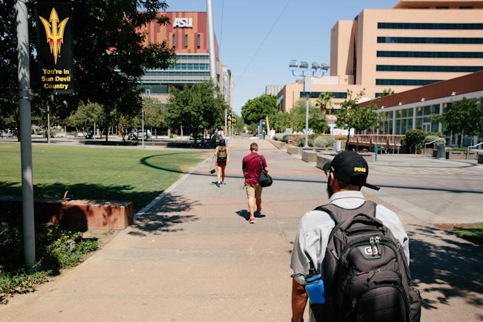 Edder Díaz Martinez walks through the downtown campus of Arizona State University on June 14. (Photo: Caitlin O'Hara for Yahoo News)