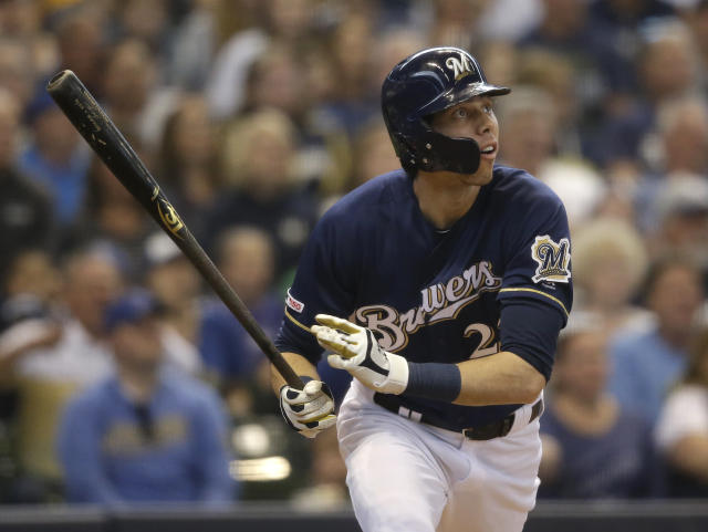 Milwaukee Brewers' Christian Yelich watches his home run against the Pittsburgh Pirates during the sixth inning of a baseball game Sunday, June 9, 2019, in Milwaukee. (AP Photo/Jeffrey Phelps)