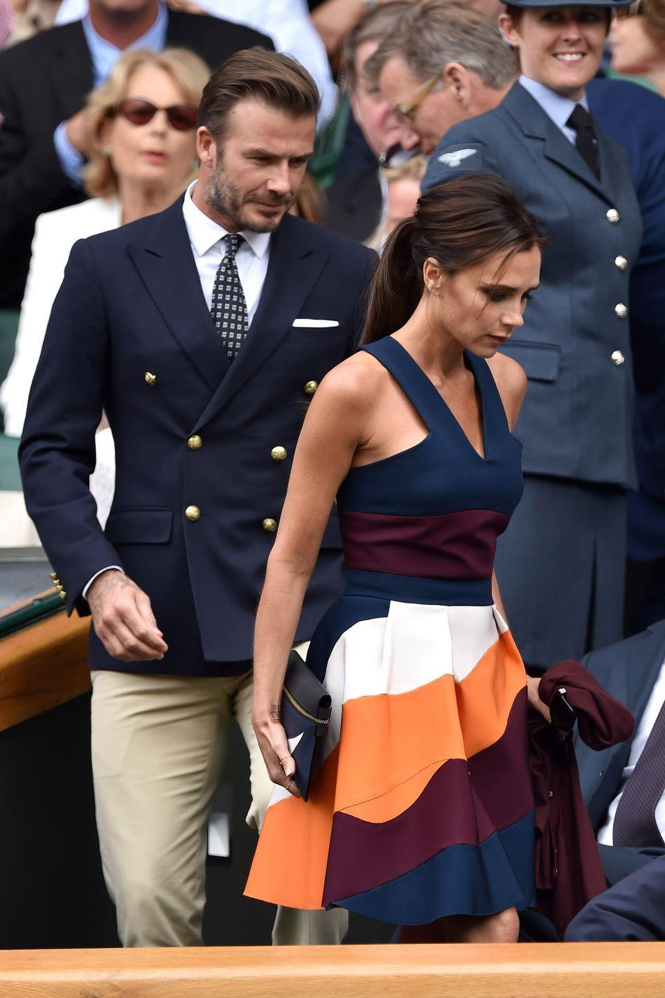 <p><strong>2014</strong> Victoria Beckham chose a striped dress from her own collection.</p>