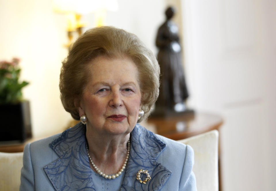 Britain's former Prime Minister Margaret Thatcher looks towards the camera as she meets Prime Minister David Cameron inside 10 Downing Street in London June 8, 2010.  REUTERS/Suzanne Plunkett (BRITAIN - Tags: POLITICS PROFILE)