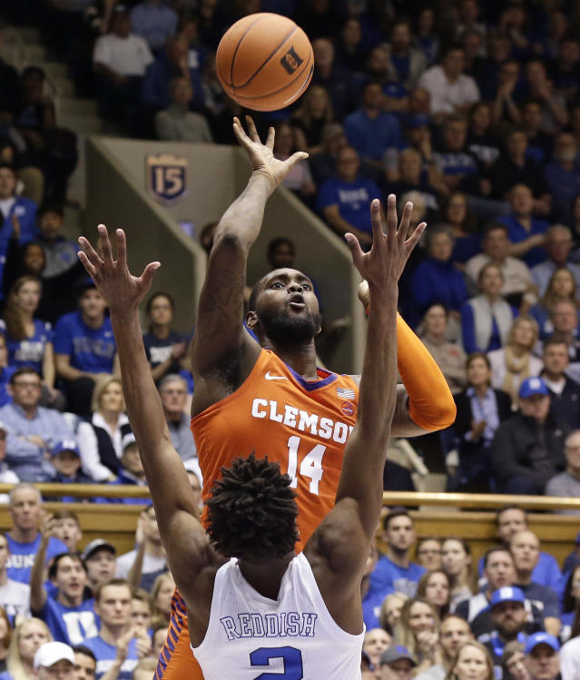 Clemson's Elijah Thomas (14) shoots while Duke's Cam Reddish (2) defends during the first half of an NCAA college basketball game in Durham, N.C., Saturday, Jan. 5, 2019. (AP Photo/Gerry Broome)