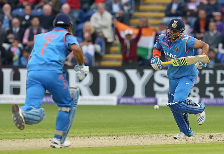 India's Suresh Raina (right) and MS Dhoni run between the wickets during the second one-day international match between England and India at the Glamorgan County Cricket Ground in Cardiff, Wales on August 27, 2014