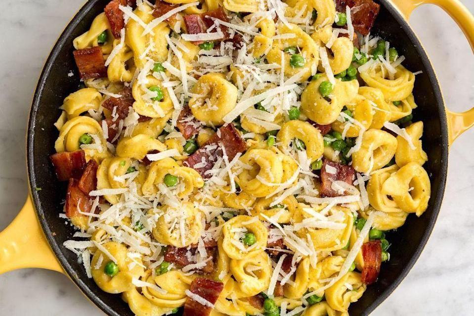 """<p>If you love bacon and cheese, say hello to this amazingly easy spring pasta.</p><p>Get the <a href=""""https://www.delish.com/uk/cooking/recipes/a35898623/cheese-tortellini-with-peas-and-bacon-recipe/"""" rel=""""nofollow noopener"""" target=""""_blank"""" data-ylk=""""slk:Cheese Tortellini with Peas & Bacon"""" class=""""link rapid-noclick-resp"""">Cheese Tortellini with Peas & Bacon</a> recipe.</p>"""