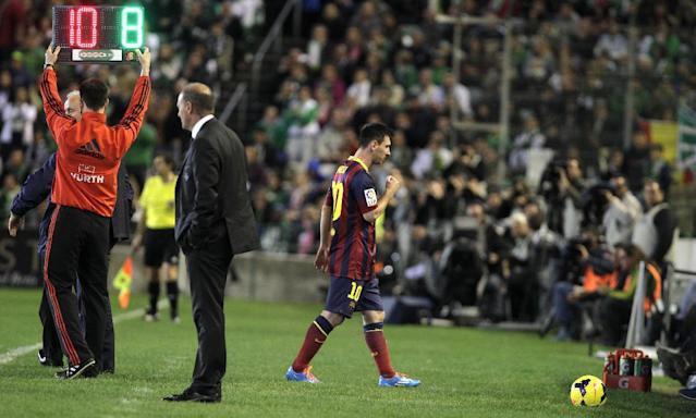 Barcelona's Lionel Messi from Argentina is substituted during their La Liga soccer match at the Benito Villamarin stadium, in Seville, Spain, Sunday, Nov. 10, 2013. (AP Photo/Angel Fernandez)