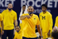 FILE - Michigan head coach Juwan Howard directs from the sideline during the second half of an NCAA college basketball game against Michigan State in Ann Arbor, Mich., in this Thursday, March 4, 2021, file photo. Michigan coach Juwan Howard was honored as The Associated Press men's basketball coach of the year Thursday, April 1, 2021.(AP Photo/Carlos Osorio, File)