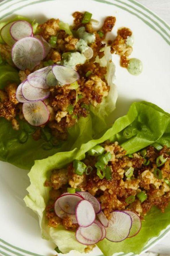 """<p>These lean dinner cups are nice and crunchy thanks to radishes and lettuce. Drizzle some cilantro sauce on top for that extra touch. </p><p><a href=""""https://www.womansday.com/food-recipes/food-drinks/a19123922/thai-turkey-lettuce-cups-recipe/"""" rel=""""nofollow noopener"""" target=""""_blank"""" data-ylk=""""slk:Get the Thai Turkey Lettuce Cups recipe."""" class=""""link rapid-noclick-resp""""><em>Get the Thai Turkey Lettuce Cups recipe.</em></a> </p>"""