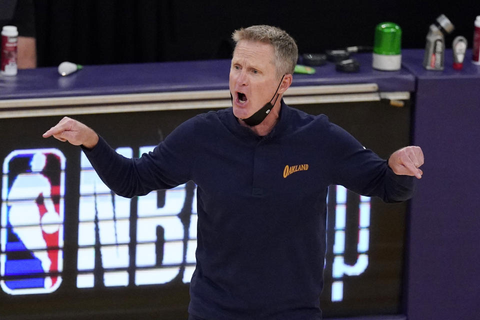 Golden State Warriors head coach Steve Kerr yells at referees during the second half of an NBA basketball Western Conference Play-In game against the Los Angeles Lakers Wednesday, May 19, 2021, in Los Angeles. (AP Photo/Mark J. Terrill)