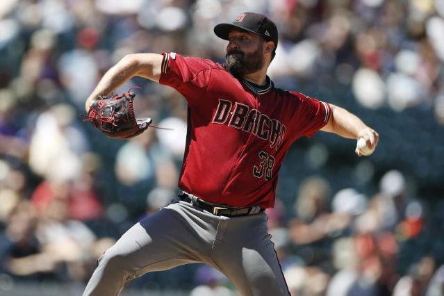 Arizona Diamondbacks starting pitcher Robbie Ray works against the Colorado Rockies in the first inning of a baseball game Wednesday, Aug. 14, 2019, in Denver. (AP Photo/David Zalubowski)