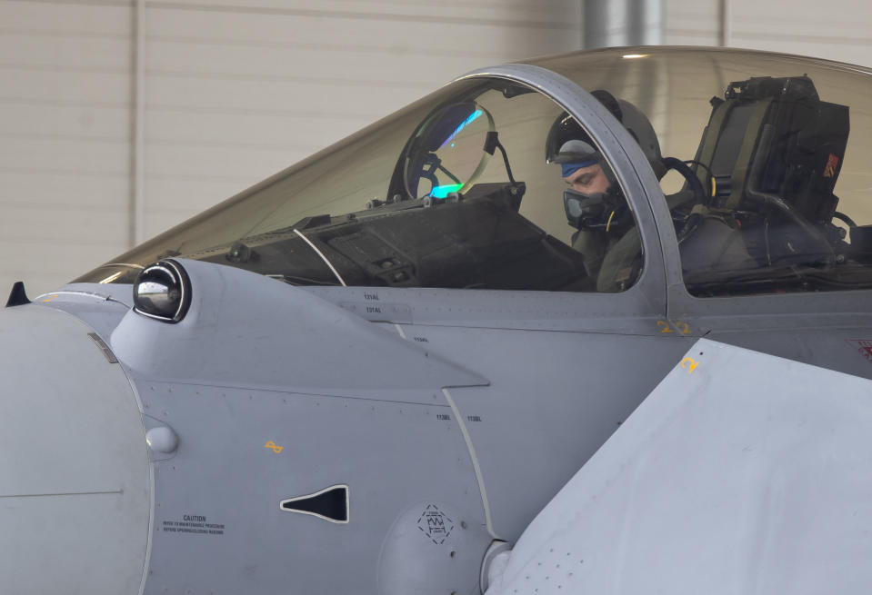 Spain's Eurofighter Typhoon jet fighter pilot prepares for take off during NATO's Baltic Air Policing Mission during the Lithuania's President Gitanas Nauseda and Spain's Prime Minister Pedro Sanchez visit at the Siauliai military air force base some 220 kms (136,7 miles) east of the capital Vilnius, Lithuania, Thursday, July 8, 2021. (AP Photo/Mindaugas Kulbis)