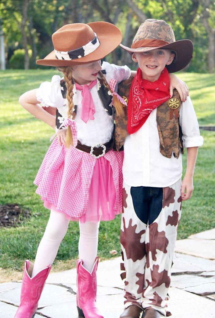 """<p>Your kids will love getting the chance to dress up like the cowboys and cowgirls in their favorite Western movies. (And how awesome are those pink cowgirl boots?)</p><p><strong>Get the tutorial at <a href=""""http://thecraftingchicks.com/boy-girl-twin-costume-idea-cowgirl-cowboy/"""" rel=""""nofollow noopener"""" target=""""_blank"""" data-ylk=""""slk:Crafting Chicks"""" class=""""link rapid-noclick-resp"""">Crafting Chicks</a>.</strong></p><p><strong><a class=""""link rapid-noclick-resp"""" href=""""https://go.redirectingat.com?id=74968X1596630&url=https%3A%2F%2Fwww.walmart.com%2Fsearch%2F%3Fquery%3Dcowboy%2Bhats&sref=https%3A%2F%2Fwww.thepioneerwoman.com%2Fholidays-celebrations%2Fg33925966%2Fwestern-halloween-costumes%2F"""" rel=""""nofollow noopener"""" target=""""_blank"""" data-ylk=""""slk:SHOP COWBOY HATS"""">SHOP COWBOY HATS</a><br></strong></p>"""