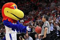 <p>The Kansas Jayhawks mascot interacts with a referee during the first half of the game between the Northeastern Huskies and the Kansas Jayhawks in the first round of the 2019 NCAA Men's Basketball Tournament at Vivint Smart Home Arena on March 21, 2019 in Salt Lake City, Utah. (Photo by Patrick Smith/Getty Images) </p>