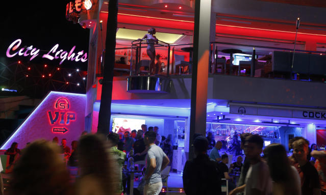 The teenagers were on the popular Punta Ballena strip in Magaluf, Spain, when they tried to pay for drinks with Monopoly money (Picture: Clara Margais/Getty Images)
