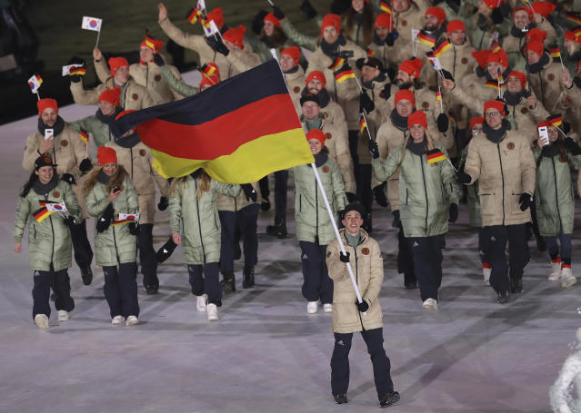 <p>Eric Frenzel carries the flag of Germany during the opening ceremony of the 2018 Winter Olympics in Pyeongchang, South Korea, Friday, Feb. 9, 2018. (AP Photo/Michael Sohn) </p>
