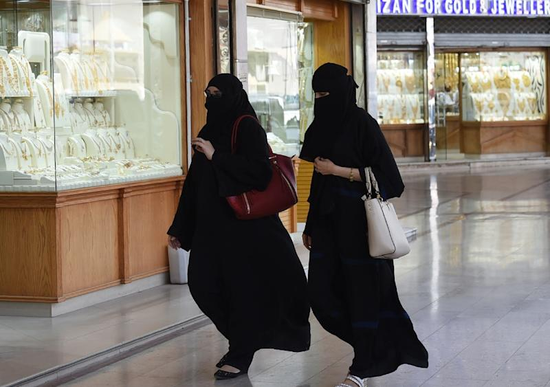 Saudi Arabia, which has some of the world's tightest restrictions on women, requires them to wear abayas by law (AFP Photo/FAYEZ NURELDINE)