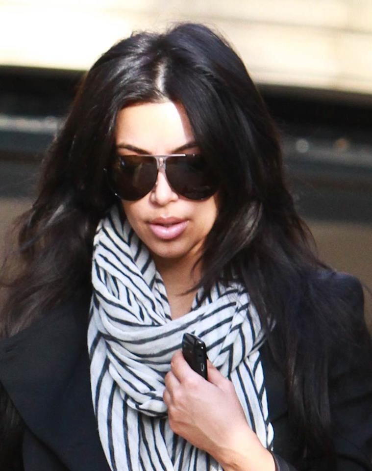 "Um ... is it just us, or did Kim Kardashian decide to plump-up her puckers? We constantly look at inflated faces here at omg!, and those lips don't look legit. Araujo/<a href=""http://www.splashnewsonline.com"" target=""new"">Splash News</a> - January 6, 2011"