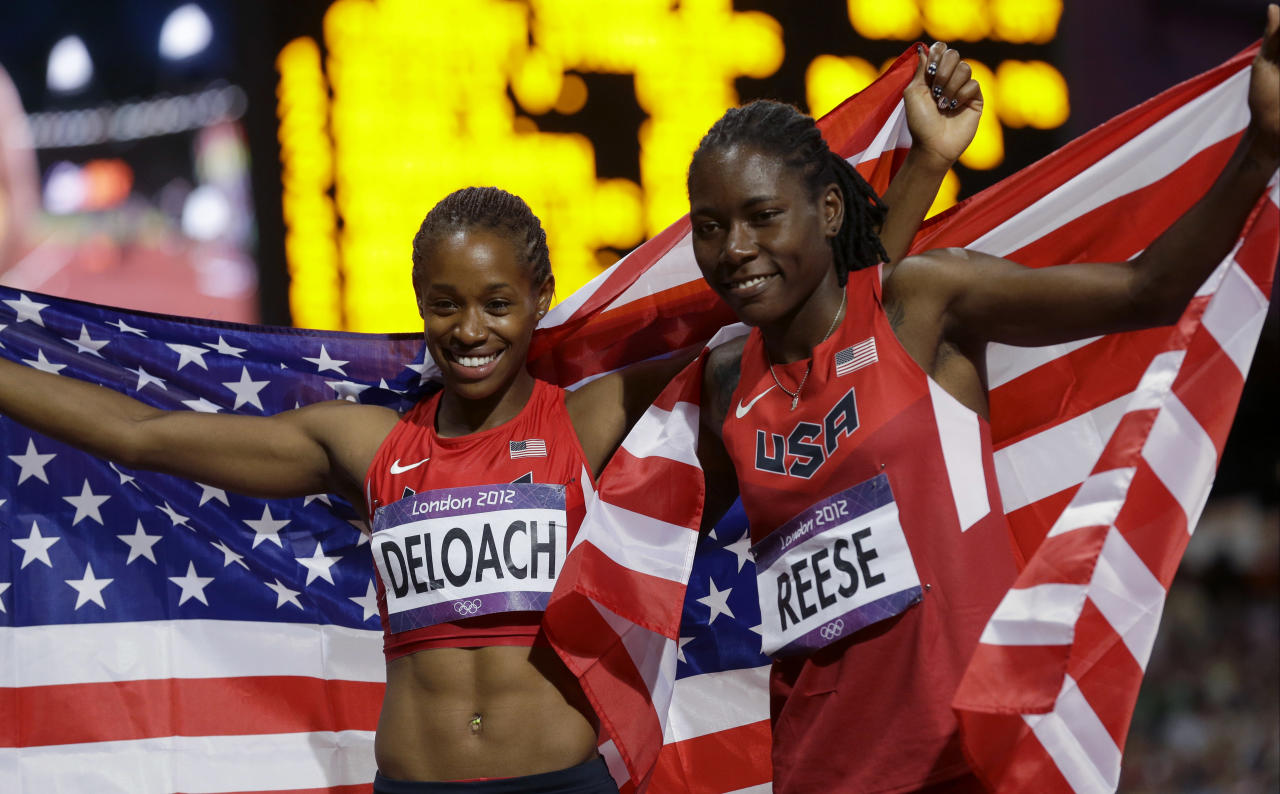 United States' bronze medalist Janay DeLoach, left, and gold medalist United States' Brittney Reese, right, celebrate thrir wins in the women's long jump during the athletics in the Olympic Stadium at the 2012 Summer Olympics, London, Wednesday, Aug. 8, 2012. (AP Photo/Ben Curtis)
