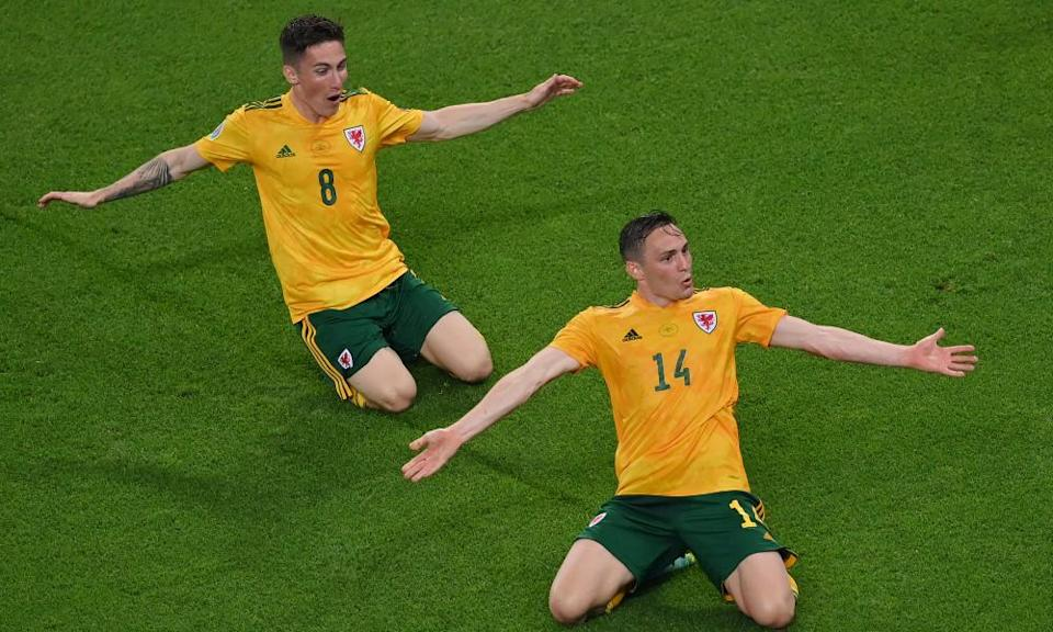 Connor Roberts celebrates with Harry Wilson after scoring Wales's second goal, deep in added time