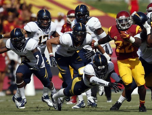 Southern California running back Curtis McNeal (22), right, runs with the ball during the first half of an NCAA college football game against California in Los Angeles, Saturday, Sept. 22, 2012. (AP Photo/Jae C. Hong)
