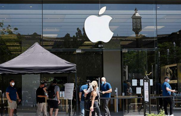 PHOTO:People wait in line to enter the Apple Store in Glendale, Calif., June 23, 2020. (Robyn Beck/AFP via Getty Images, FILE)