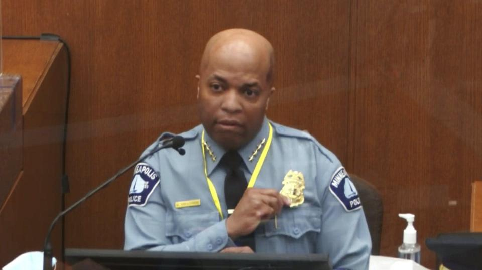 Minneapolis Police Chief Medaria Arradondo in the witness box at the Chauvin trial, fingering his badge.