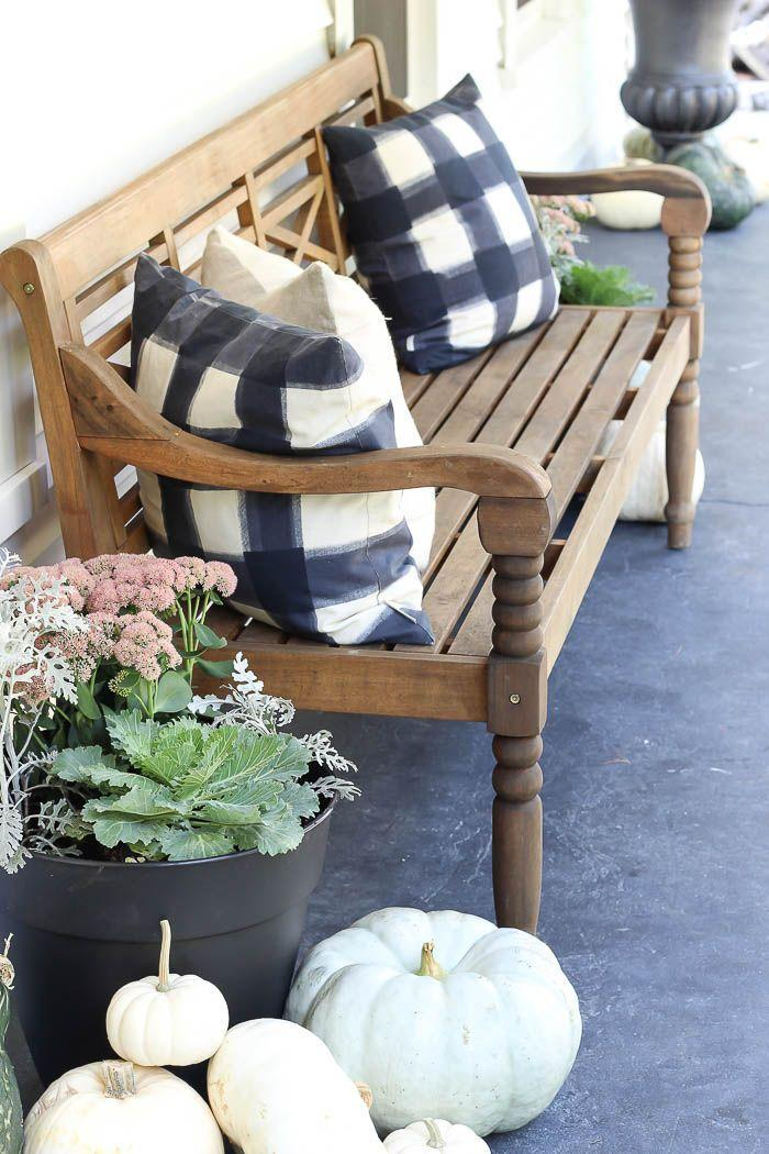 """<p>The typical autumnal palette is beautiful, don't get us wrong. But if you're getting tired of seeing the same décor pieces year after year, try mixing things up with deep blue hues. Neutral-toned pumpkins keep this vignette appropriately seasonal.</p><p><strong>See more at <a href=""""https://roomsforrentblog.com/2018/09/fall-porch-2018/"""" rel=""""nofollow noopener"""" target=""""_blank"""" data-ylk=""""slk:Rooms for Rent"""" class=""""link rapid-noclick-resp"""">Rooms for Rent</a>.</strong></p><p><a class=""""link rapid-noclick-resp"""" href=""""https://go.redirectingat.com?id=74968X1596630&url=https%3A%2F%2Fwww.walmart.com%2Fbrowse%2Fhome%2Fthe-pioneer-woman-decor%2F4044_133012_3812631%3Ffacet%3Dfacet_product_type%253APlaques%2B%2526%2BSigns&sref=https%3A%2F%2Fwww.thepioneerwoman.com%2Fhome-lifestyle%2Fdecorating-ideas%2Fg36732301%2Foutdoor-fall-decorations%2F"""" rel=""""nofollow noopener"""" target=""""_blank"""" data-ylk=""""slk:SHOP PORCH DECORATIONS""""><strong>SHOP PORCH DECORATIONS</strong> </a></p>"""