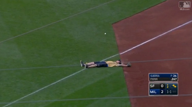 This Brewers ballboy had a tough time with his ground ball. (MLB.com Screenshot)