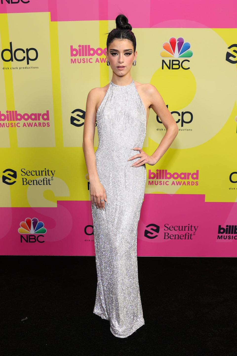 <p>Wearing a sparkly silver dress and Stuart Weitzman.</p>