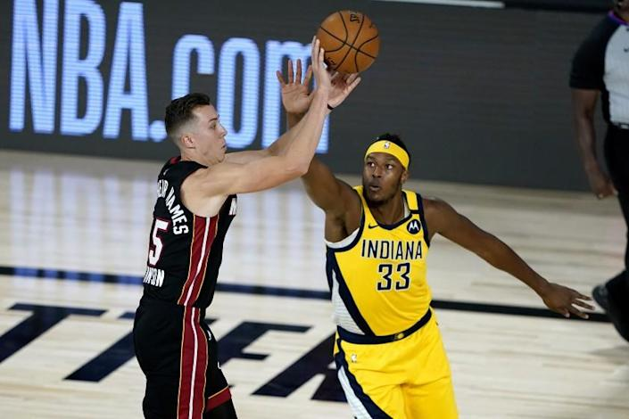 "Heat forward Duncan Robinson shoots before Pacers center Myles Turner can make the block on Aug. 20. <span class=""copyright"">(Ashley Landis / Associated Press)</span>"