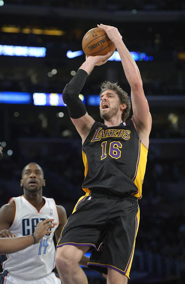 Los Angeles Lakers center Pau Gasol, right, shoots as Charlotte Bobcats forward Michael Kidd-Gilchrist watches during the first half of an NBA basketball game, Friday, Jan. 31, 2014, in Los Angeles. (AP Photo/Mark J. Terrill)