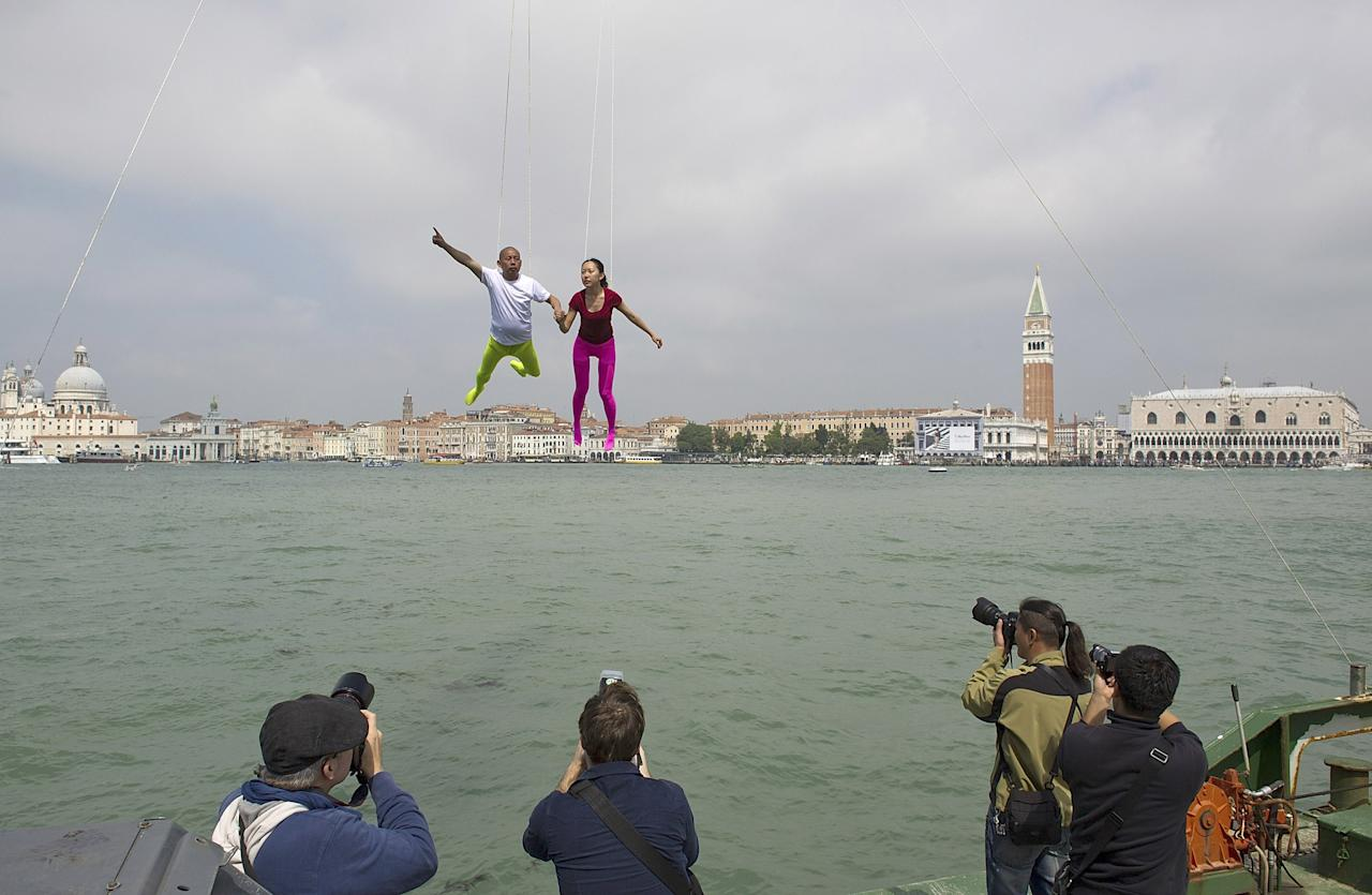 VENICE, ITALY - MAY 28:  Chinese artist Li Wei and his assistant perform in front of Saint's Mark as part of the 55th International Art Exhibition on May 28, 2013 in Venice, Italy. The 55th International Art Exhibition of La Biennale di Venezia will be open to the public from the June 1 - November 24, 2013.  (Photo by Marco Secchi/Getty Images)