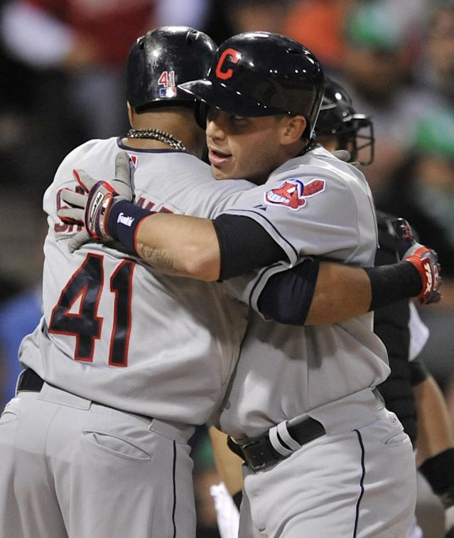 Cleveland Indians' Asdrubal Cabrera right, celebrates with Carlos Santana (41) at home plate after hitting a two-run home run during the fourth inning of a baseball game against the Chicago White Sox in Chicago, Saturday, Sept. 14, 2013. (AP Photo/Paul Beaty)