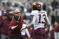 Minnesota head coach P.J. Fleck left, celebrates with wide receiver Rashod Bateman (13) after Bateman caught a touchdown pass during the first half of an NCAA football game against Northwestern, Saturday, Nov. 23, 2019, in Evanston, Ill. (AP Photo/Paul Beaty)