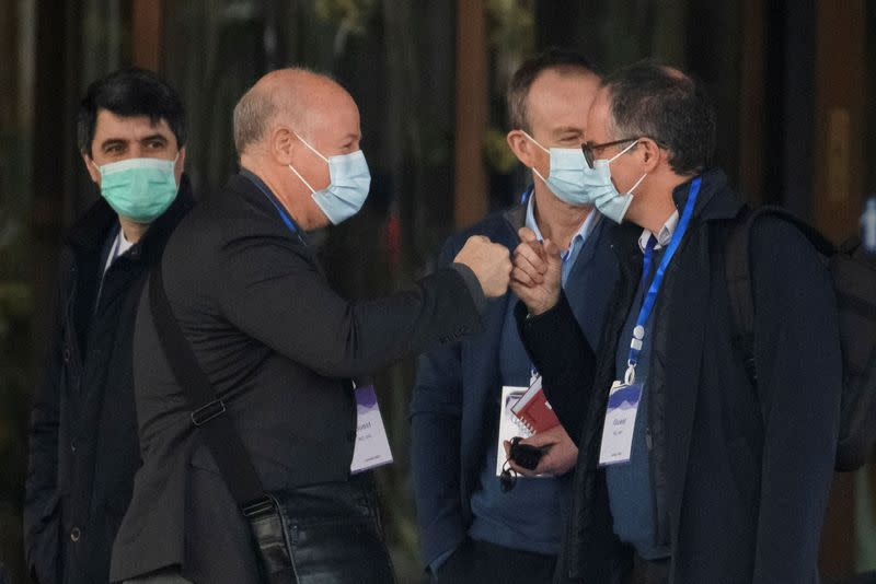Members of the World Health Organization team, tasked with investigating the origins of the coronavirus disease (COVID-19), Peter Daszak and Peter Ben Embarek fist-bump as they leave their hotel in Wuhan