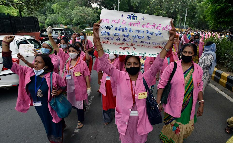 ASHA workers protest against alleged negligence of their workforce by the government on August 9, 2020 in New Delhi. During the protest, ASHA workers demanded payment for their work during the COVID-19 pandemic, saying they have not been paid for the past few months.