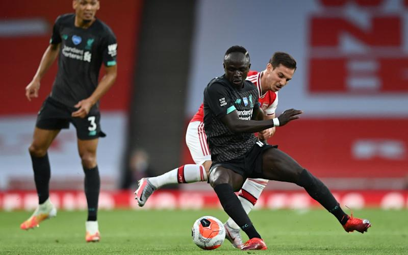 Cedric Soares battles for the ball with Sadio Mane - REUTERS
