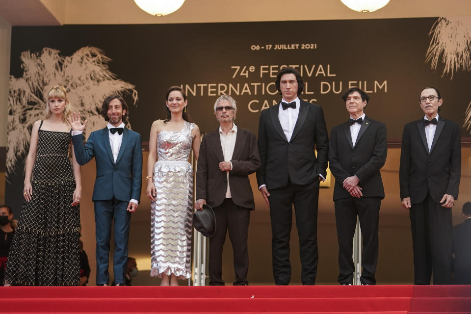 Angele, from left Simon Helberg, Marion Cotillard, director Leos Carax, Adam Driver, Russell Mael, and Ron Mael pose for photographers upon arrival at the premiere of the film 'Annette' and the opening ceremony of the 74th international film festival, Cannes, southern France, Tuesday, July 6, 2021. (AP Photo/Brynn Anderson)