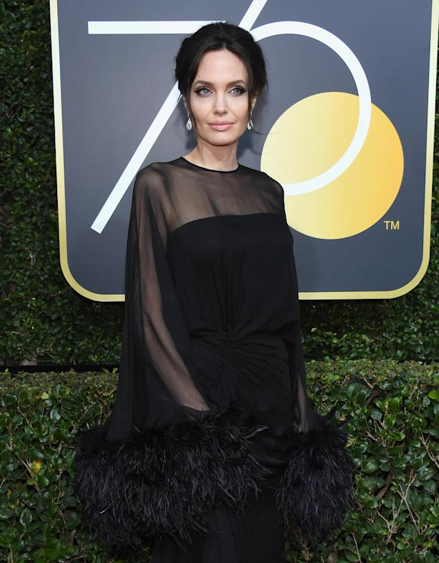"As a mom of six, Angelina Jolie, pictured at the 75th Golden Globe Awards on Sunday, knows how to give ""the look"" — and she gave it to line cutters in the bathroom of the Beverly Hilton Hotel ballroom. (Photo: Kevork Djansezian/NBC/NBCU Photo Bank via Getty Images)"