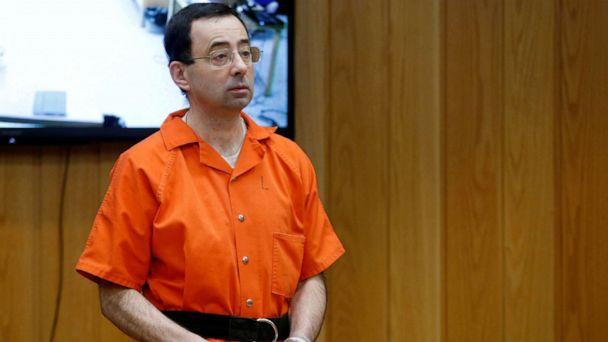 FILE PHOTO: Larry Nassar, a former team USA Gymnastics doctor who pleaded guilty in November 2017 to sexual assault charges, stands in court during his sentencing hearing in the Eaton County Court in Charlotte, Michigan, U.S., Feb. 5, 2018.   (Rebecca Cook/Reuters)