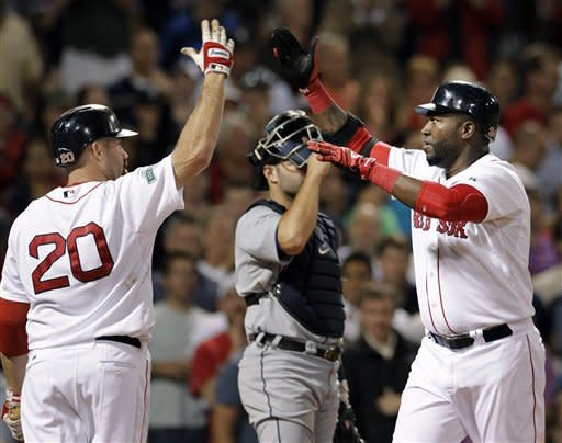 Boston Red Sox's David Ortiz, right, celebrates his solo home run against the Detroit Tigers with Kevin Youkilis (20) during the seventh inning of a baseball game at Fenway Park in Boston Tuesday, May 29, 2012. Tigers catcher Alex Avila is at center. (AP Photo/Elise Amendola)