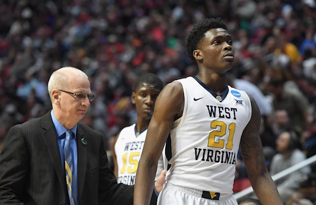 West Virginia forward Wesley Harris (R) is facing two misdemeanor charges after an alleged road rage incident last month in Morgantown, West Virginia. (Getty Images)