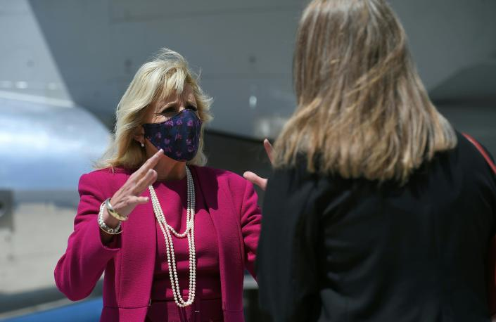 First lady Jill Biden speaks with Commissioner Charlene Pyskoty as she arrives at Albuquerque International Sunport in Albuquerque, N.M., Tuesday, April 21, 2021. (Mandel Ngan/Pool via AP)
