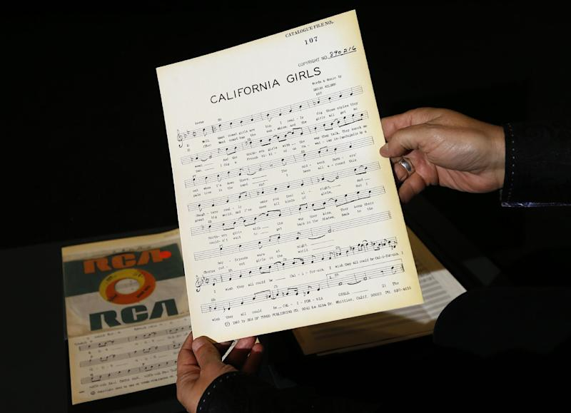 A musical manuscript of 'California Girls' is displayed in London, Thursday, April 18, 2013. A large archive collection of The Beach Boys early compositions, contracts, publishing agreements, hand written songs and hand written musical manuscripts will be auctioned this month in one lot. The archive is being auctioned by closed bidding by The Fame Bureau in London, and bids are accepted up to May 15. (AP Photo/Kirsty Wigglesworth)