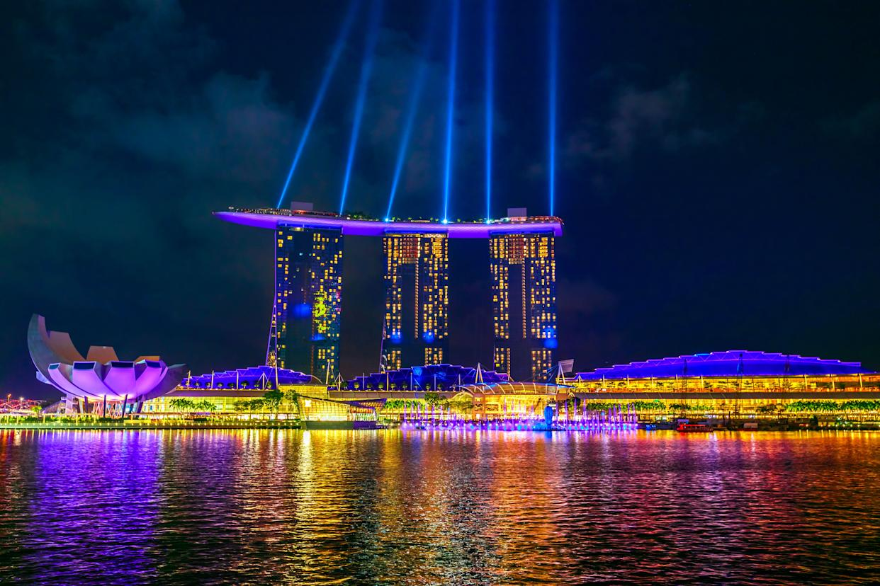 """In the book, Nick takes Rachel, Peik Lin and Kerry to the SkyBar at <a href=""""https://www.marinabaysands.com/"""" rel=""""nofollow noopener"""" target=""""_blank"""" data-ylk=""""slk:Marina Bay Sands"""" class=""""link rapid-noclick-resp"""">Marina Bay Sands</a> to drink Singapore Slings &mdash; gin-based cocktails. From the trailer, it's clear the iconic resort will feature in the movie as well."""