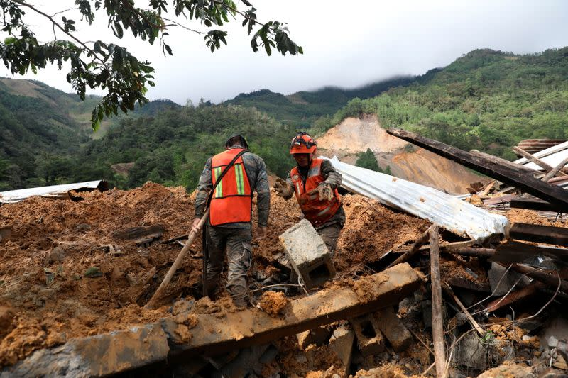 Soldiers work at an area hit by a mudslide, caused by heavy rains brought by Storm Eta, as the search for victims continue in the buried village of Queja