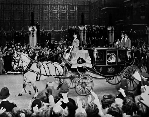 Britain's future Queen Elizabeth II and Prince Philip cheered by crowds after their wedding in 1947