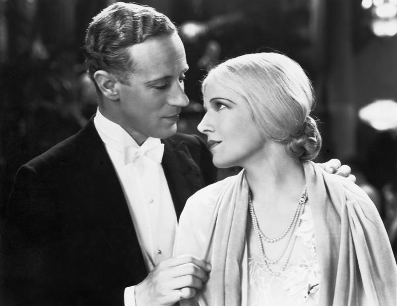David Trent (Leslie Howard) and Shirley Mortimer (Ann Harding) gaze into each other's eyes in the 1931 romantic comedy Devotion. (Photo by �� John Springer Collection/CORBIS/Corbis via Getty Images)