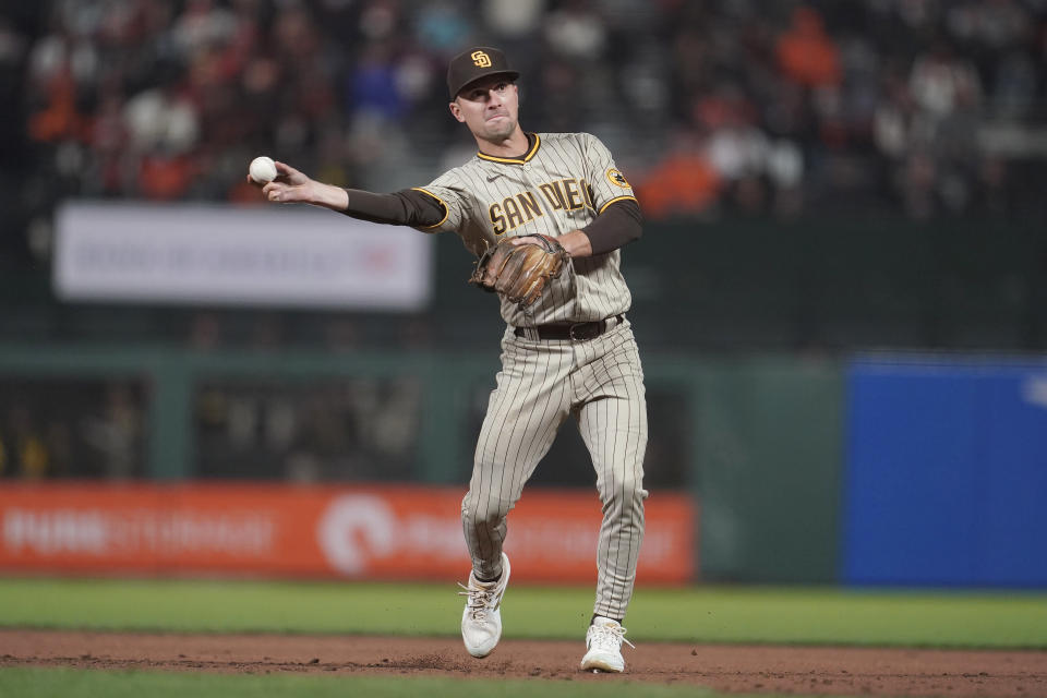 San Diego Padres second baseman Adam Frazier throws out San Francisco Giants' Brandon Belt at first base during the third inning of a baseball game in San Francisco, Wednesday, Sept. 15, 2021. (AP Photo/Jeff Chiu)