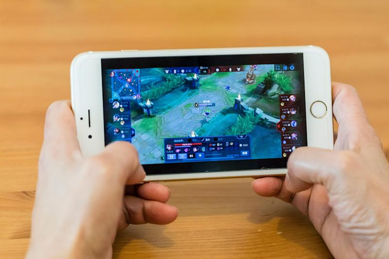 HONG KONG, HONG KONG - SEPTEMBER 11: A teenager plays Wangzhe Rongyao, variably known in English unofficial translations as King of Glory, a multiplayer online battle arena developed and published by Tencent Games for the iOS and Android mobile platforms, exclusively for the Chinese market, in Hong Kong, Hong Kong on September 11, 2018. (Photo by Yu Chun Christopher Wong/S3studio/Getty Images)