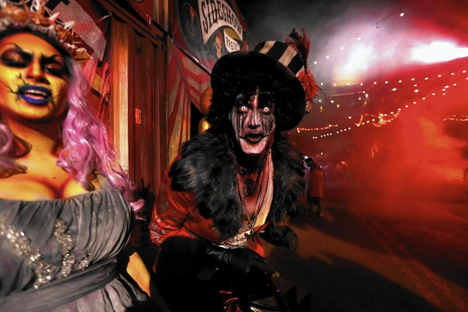 "Oceana, left, and the Ring Master greet visitors to Dark Harbor, the annual Halloween festivity on the Queen Mary in Long Beach, in 2015. <span class=""copyright"">(Genaro Molina / Los Angeles Times)</span>"