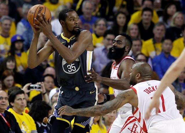 Rockets James Harden and P.J. Tucker haven't been able to slow Kevin Durant in the West semifinals. (AP)